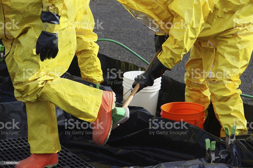 HAZMAT Team Members Clean Up Boots stock photo