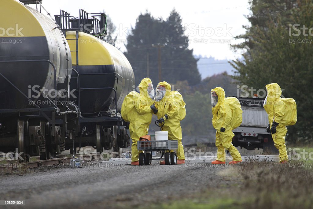 HAZMAT Team Members Discusses Chemical Disaster stock photo