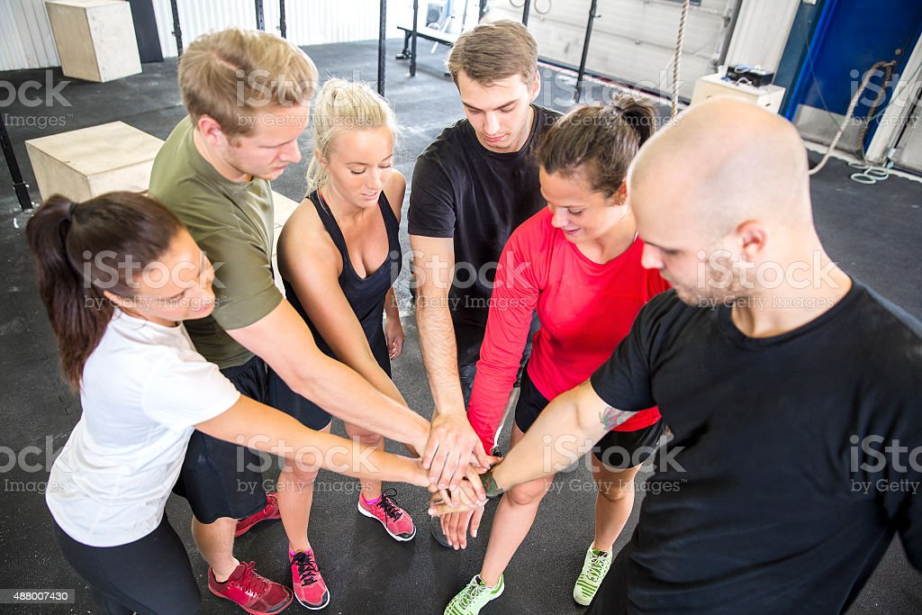 Team motivation before workout at the gym stock photo