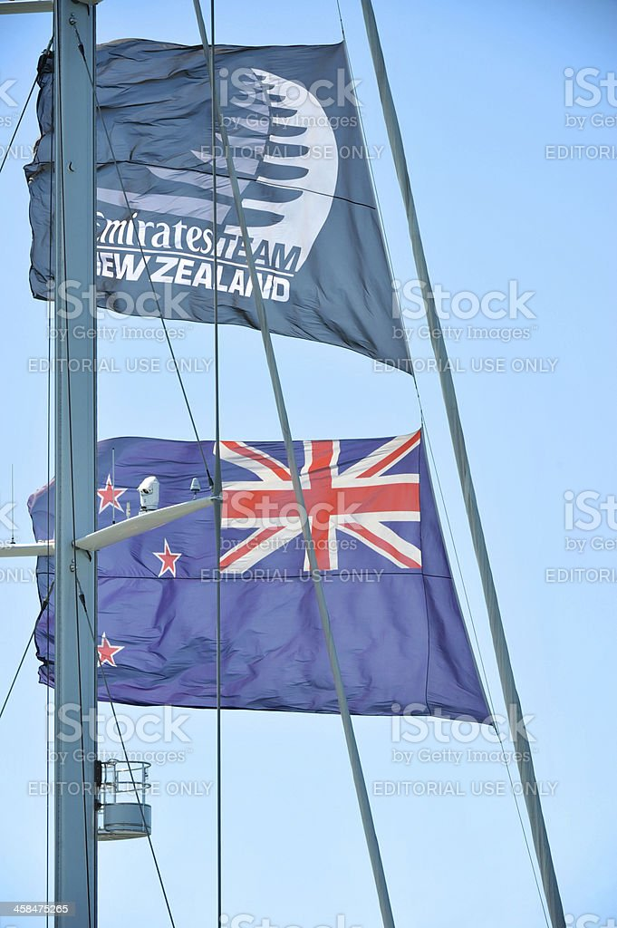 Team New Zealand flags blowing in the wind stock photo
