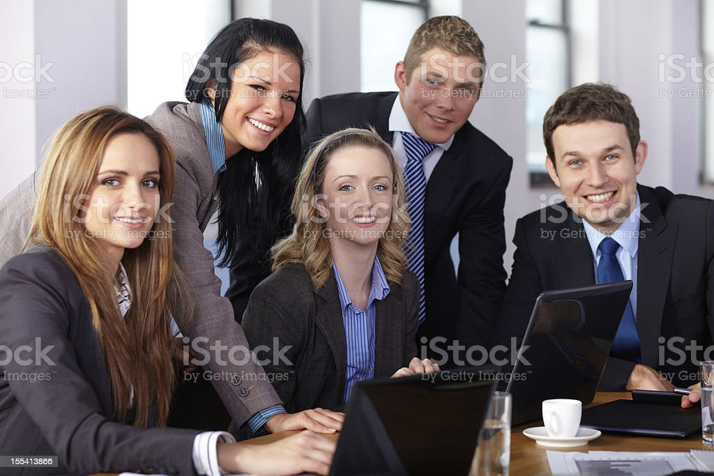 Team of 5 business people during meeting royalty-free stock photo