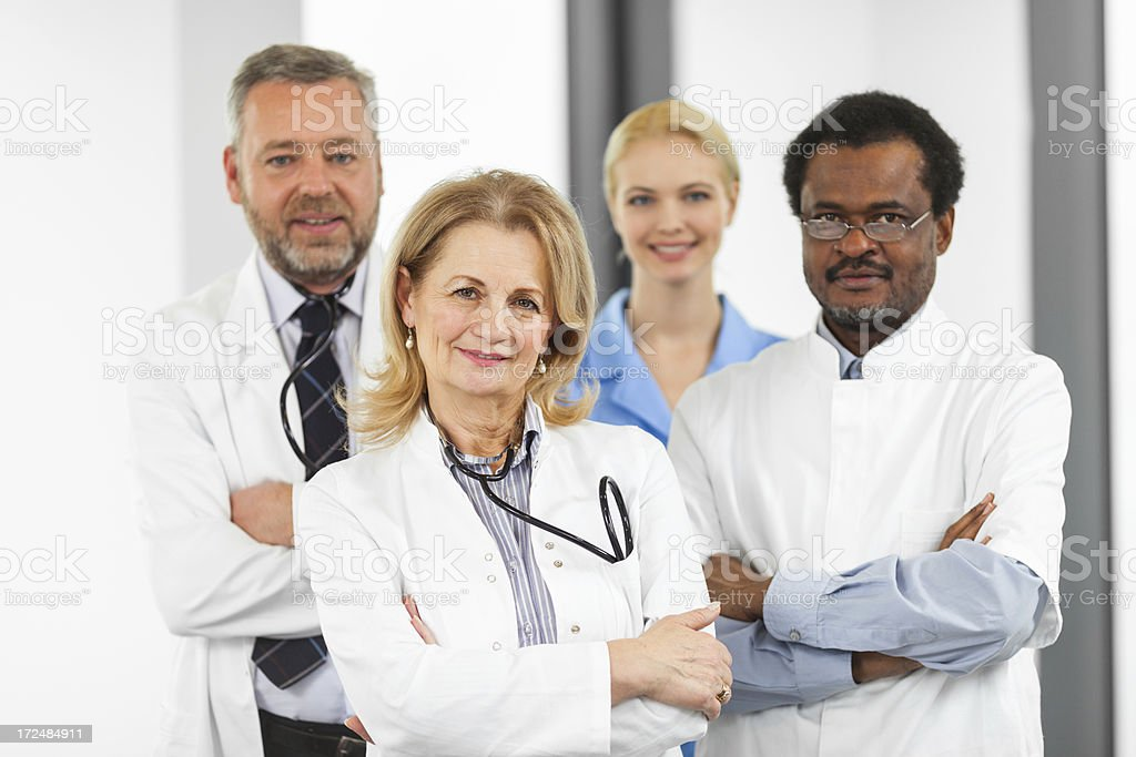Team of a happy doctors standing together royalty-free stock photo