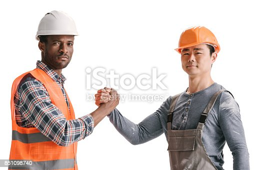 istock team of african-american and asian construction workers 851098740