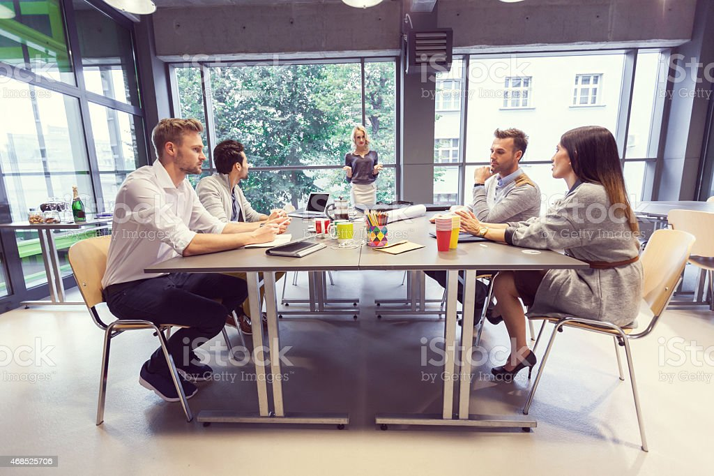 Team of architects having meeting in office stock photo