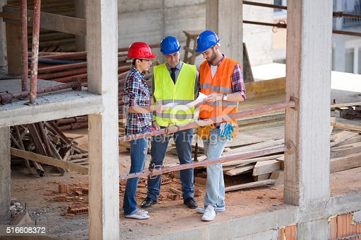 516607254istockphoto Team of architects looking plan at site 516608372
