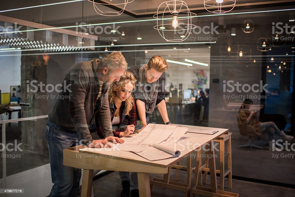 Team of architects working on a new business projects. stock photo