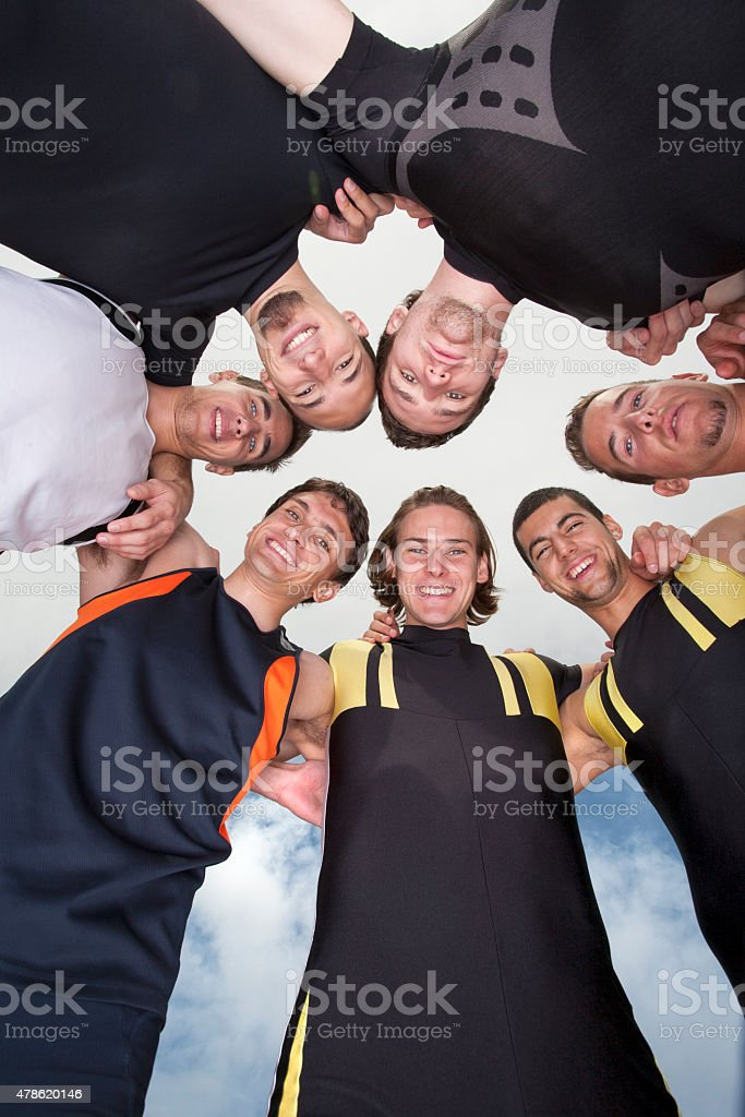 Team of athlets huddling. stock photo