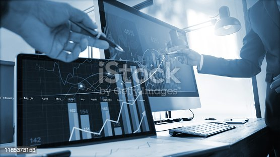 istock Team of business analysis sale data and discuss the situation on the market on business growth and progress on global network . 1185373153