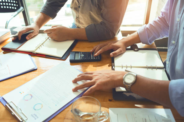 Team of business associates monthly meeting to plan for loan to buy real estate. And movable property to calculate and budget appropriately and save the most money. stock photo