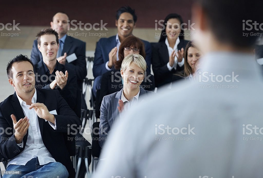 Team of business colleagues clapping hands royalty-free stock photo