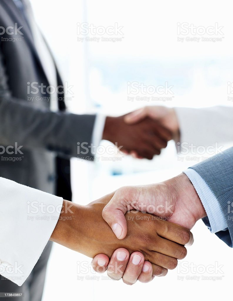 Team of business people shaking hands royalty-free stock photo