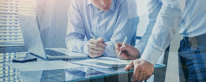 istock team of business people working together in the office, teamwork double exposure 1068752548