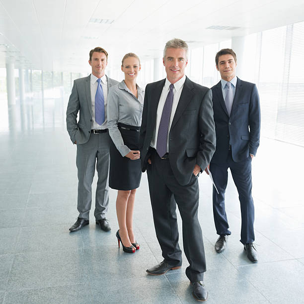 team of business professionals - four people stock photos and pictures