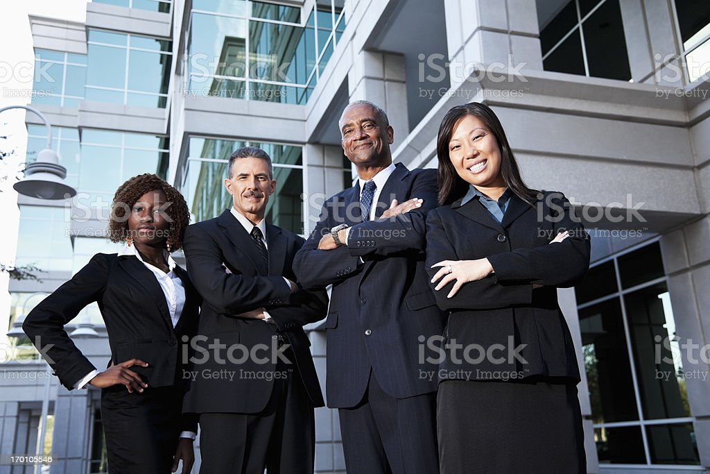 Team of businesspeople standing outside office building royalty-free stock photo