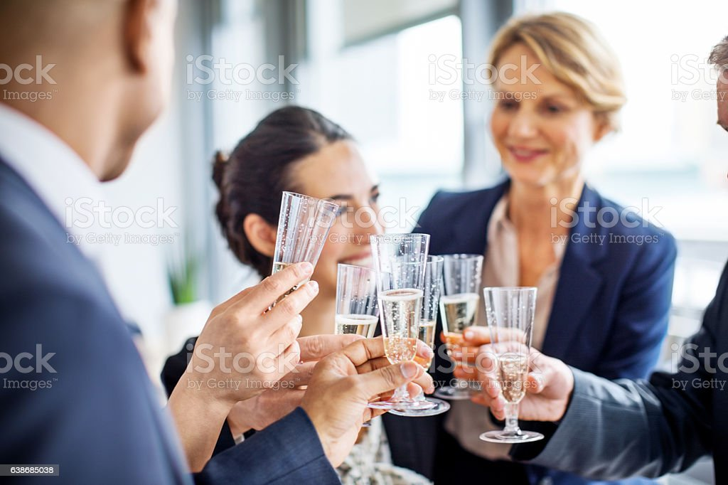 Team of businesspeople toasting champagne stock photo