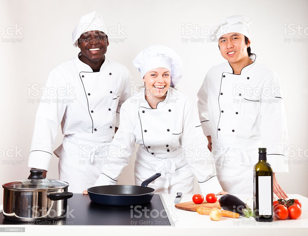 team of chefs in their kitchen royalty-free stock photo