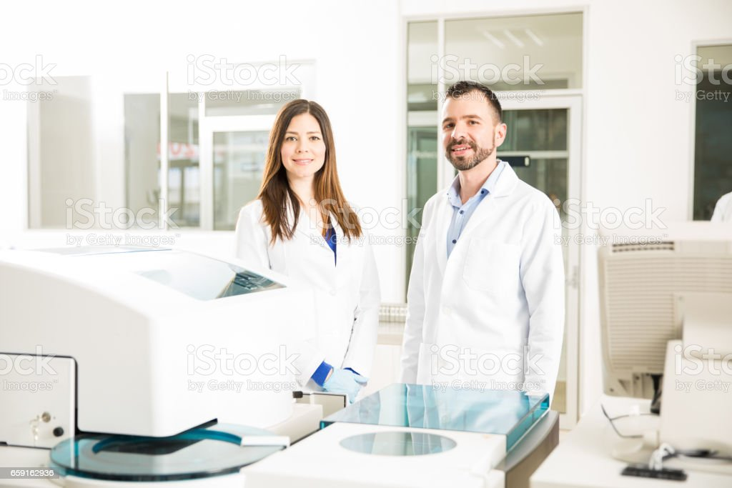 Team of chemists in a laboratory stock photo