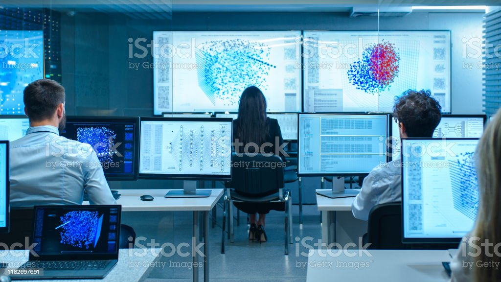Team of Computer Engineers Work on Machine Learning Neural Network Technology Development. Team of Computer Engineers Work on Machine Learning Neural Network Technology Development. Administrator Stock Photo