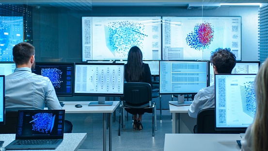 Team Of Computer Engineers Work On Machine Learning Neural Network Technology Development Stock Photo - Download Image Now
