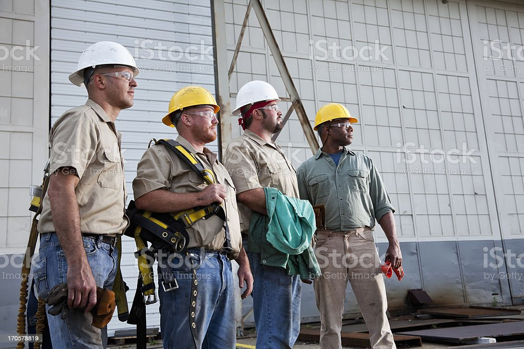 Team of construction workers with harnesses royalty-free stock photo