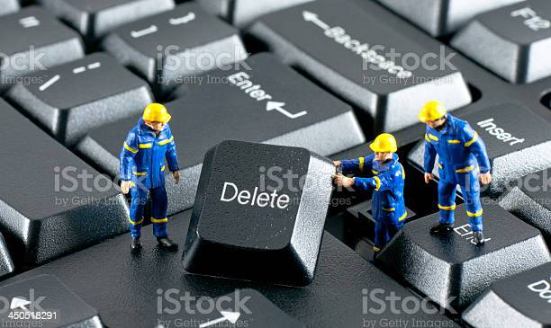 Team Of Construction Workers Working On A Computer Keyboard Stock Photo - Download Image Now