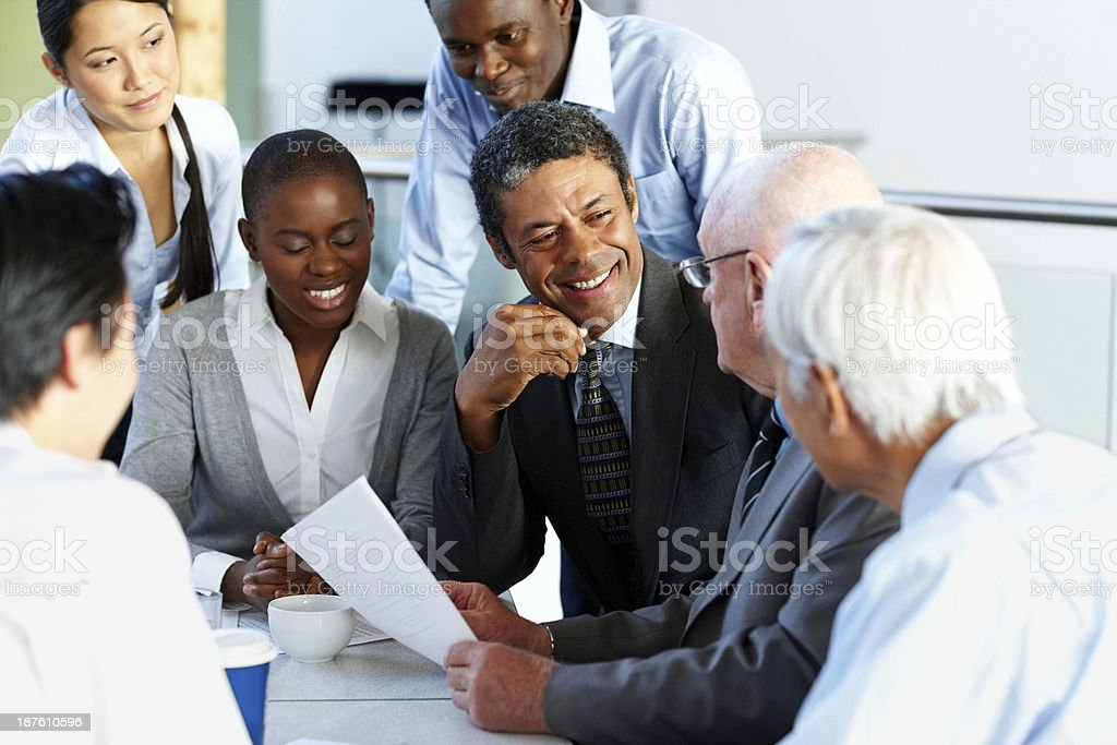 Team of corporate professionals having friendly discussion royalty-free stock photo