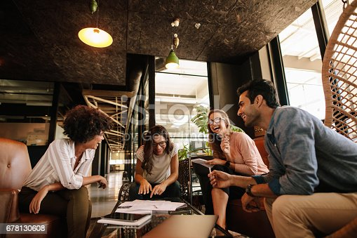 istock Team of corporate professionals having friendly discussion 678130608
