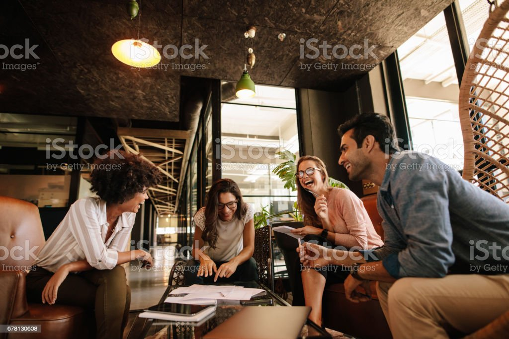 Team of corporate professionals having friendly discussion stock photo