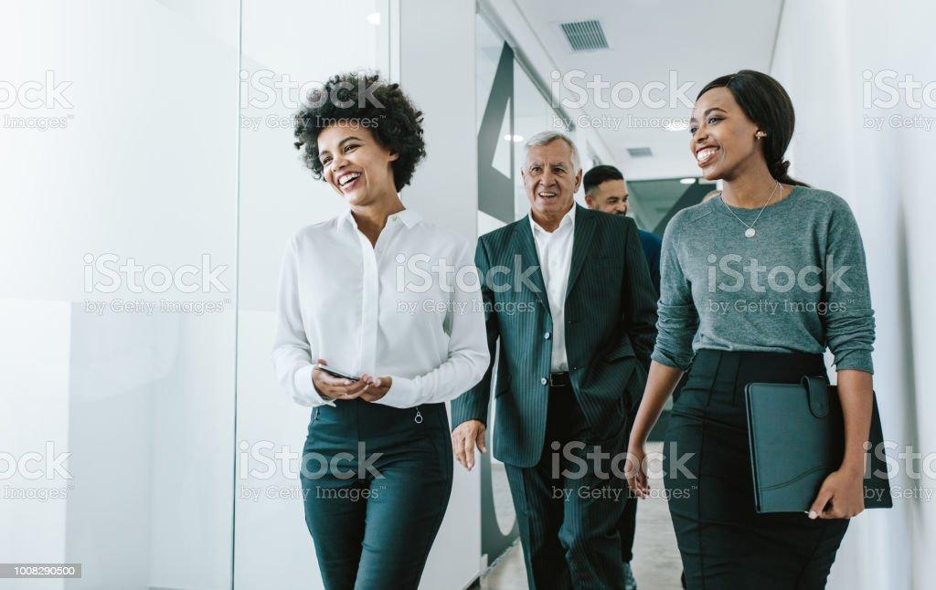 Team of corporate professionals in office corridor stock photo