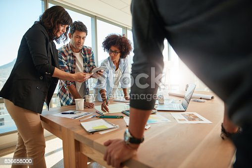 848290020istockphoto Team of creative professionals working on new project 836658000