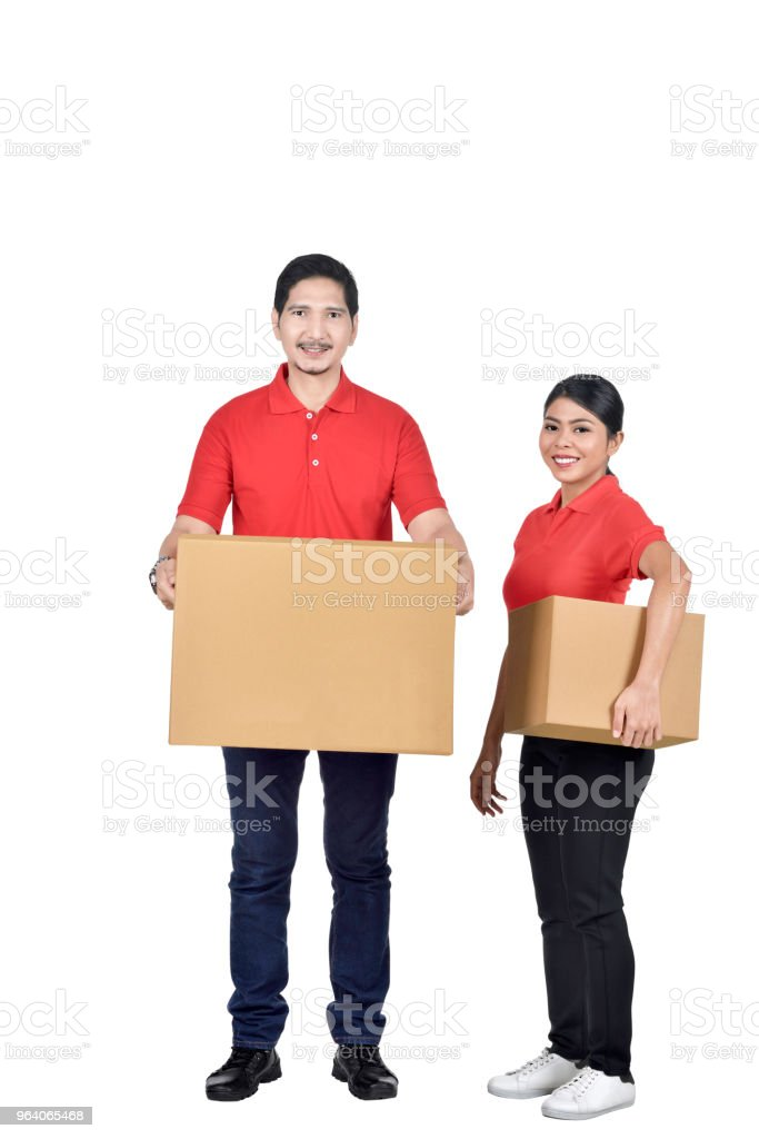Team of delivery courier with the package - Royalty-free Adult Stock Photo