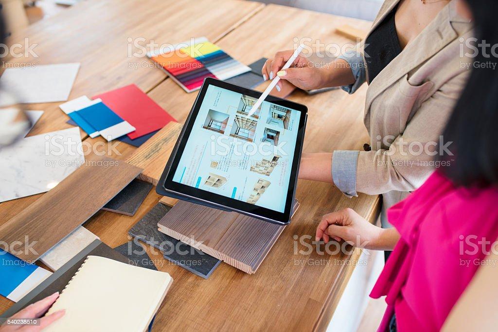 Team of designers looking at a digital tablet