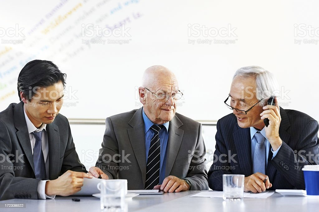 Team of diverse business people in a meeting royalty-free stock photo