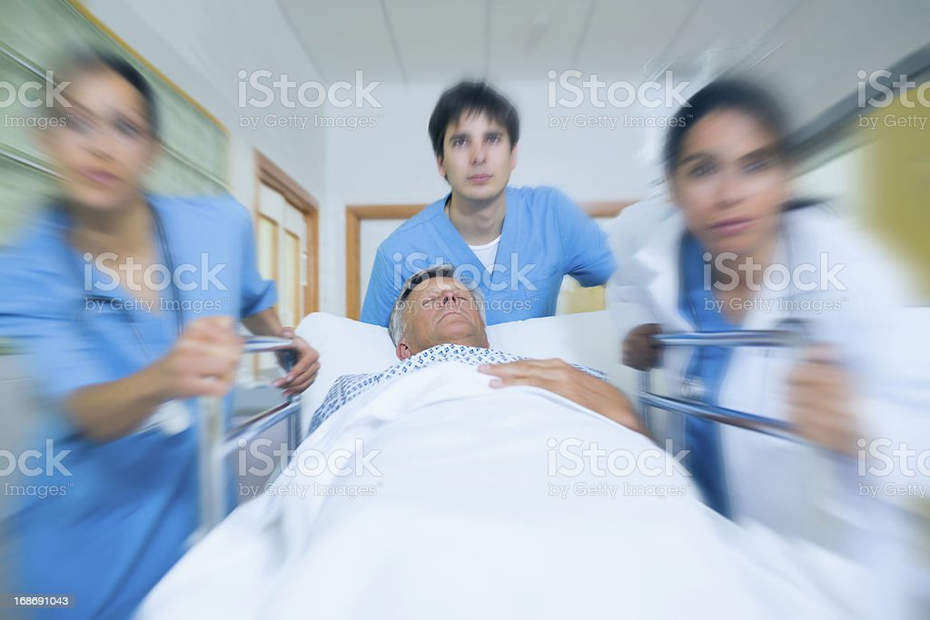 Team of doctor running in a hospital hallway royalty-free stock photo