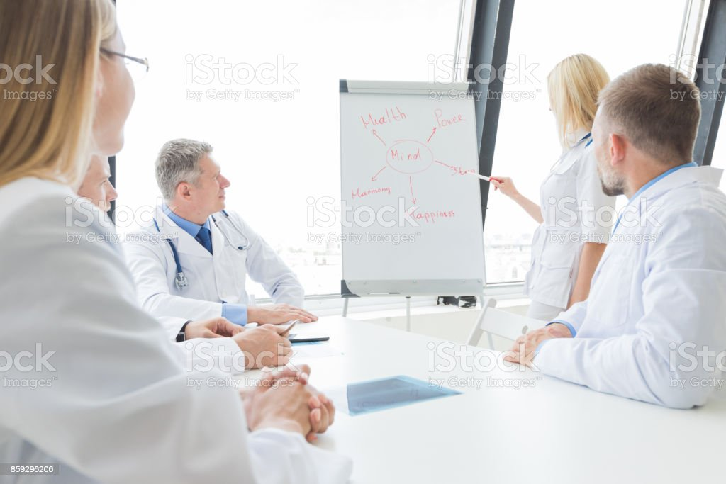 Team of doctors discuss mental health stock photo