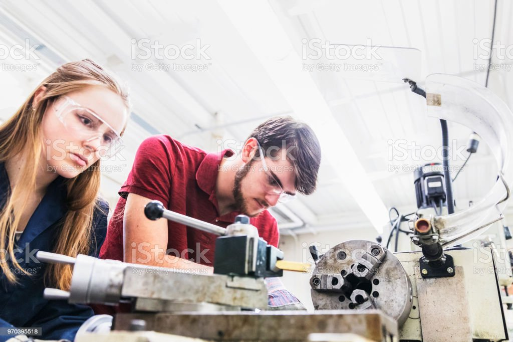 Team of engineering students working at a science lab stock photo