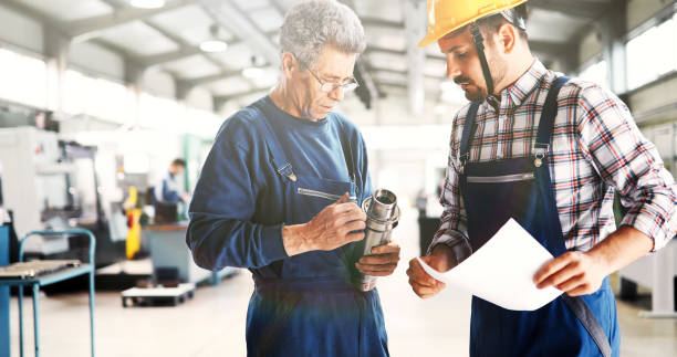 Team Of Engineers Having Discussion In Factory Team Of Engineers Having Discussion In Metal Industries Factory metal worker stock pictures, royalty-free photos & images