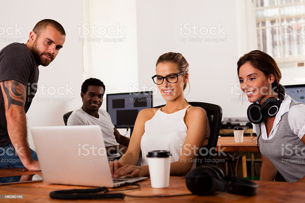 Team of entrepreneurs in a startup office stock photo