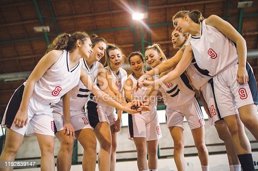 istock Team of female basketball with hands together 1192839147