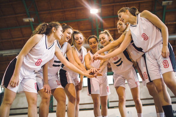 Team of female basketball with hands together stock photo