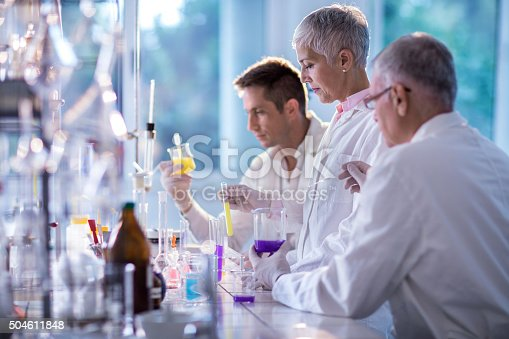 499203366istockphoto Team of forensic scientists working on an experiment in laboratory. 504611848
