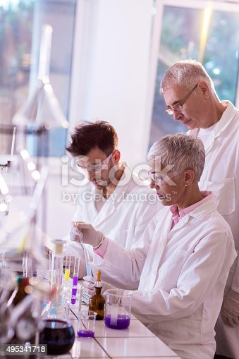 499203366istockphoto Team of forensic scientists working together on a new research. 495341718