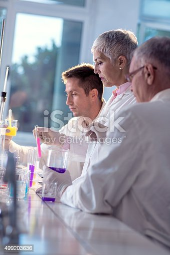 499203366istockphoto Team of forensic scientists working together on a new research. 499203636