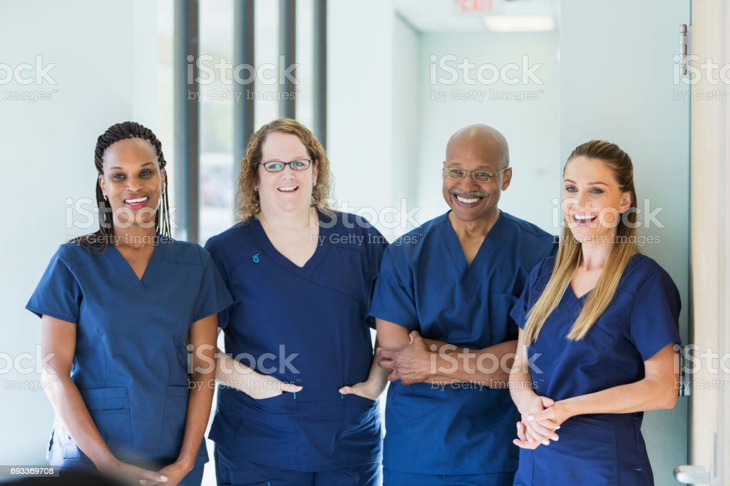 Team of four multi-ethnic medical professionals stock photo