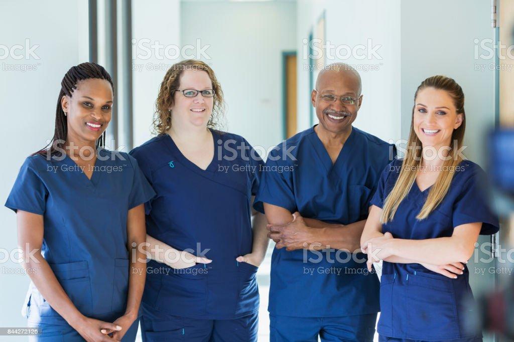 Team of four multi-ethnic medical professionals stock photo