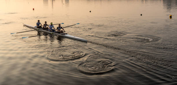 Team of four rowers practice in racing canoe stock photo