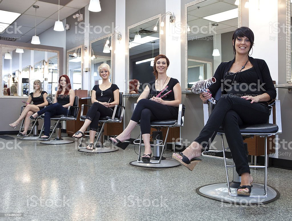 Team of Hair Stylists at a Beauty Salon stock photo