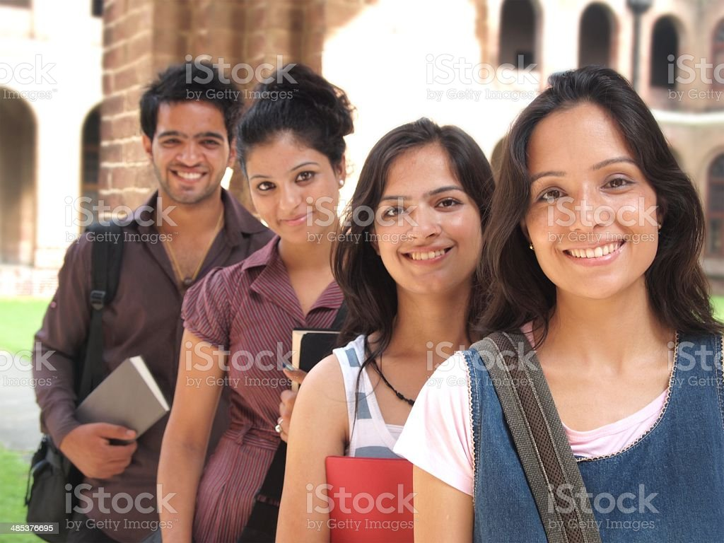 Team of happy Indian students smiling with books. stok fotoğrafı