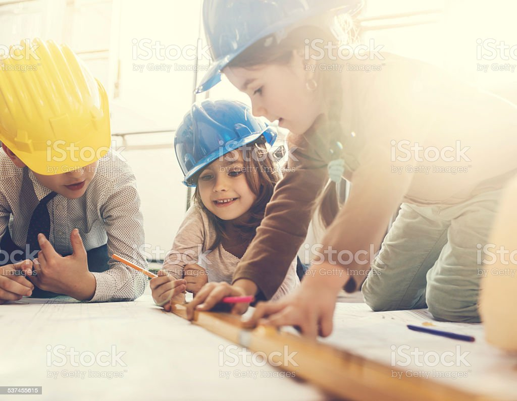Team of little engineers. stock photo