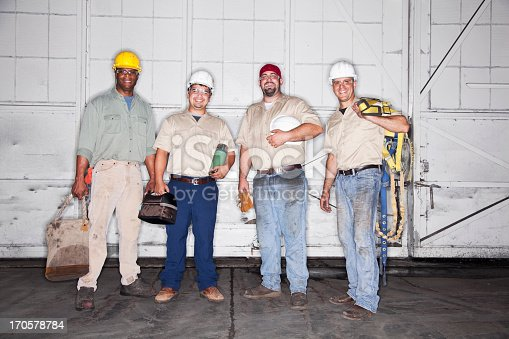 istock Team of manual workers 170578784